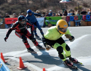 This is what inline downhill looks like in an organized race. Free skating down mountain passes in the Sierra is more like free skiing avalanche chutes except that free skating inline downhillers race each other on descents whereas free skiers don't race each other down avalanche chutes.